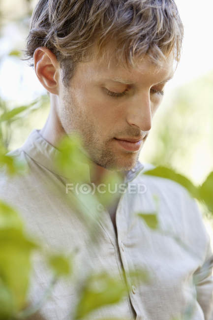 Close-up of young man thinking — Stock Photo