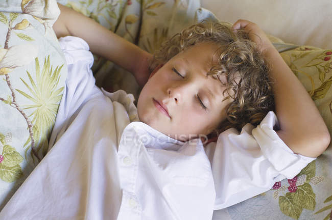 Little boy with eyes closed relaxing on couch — Stock Photo