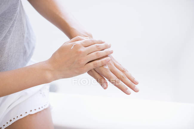Close-up of female hands applying moisturizer on hands — Stock Photo
