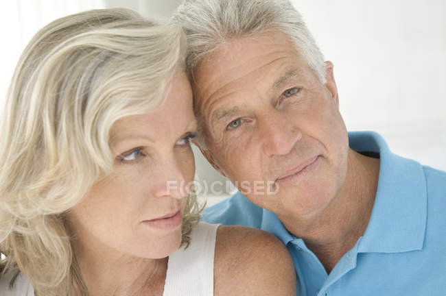 Portrait of thoughtful mature couple head to head — Stock Photo