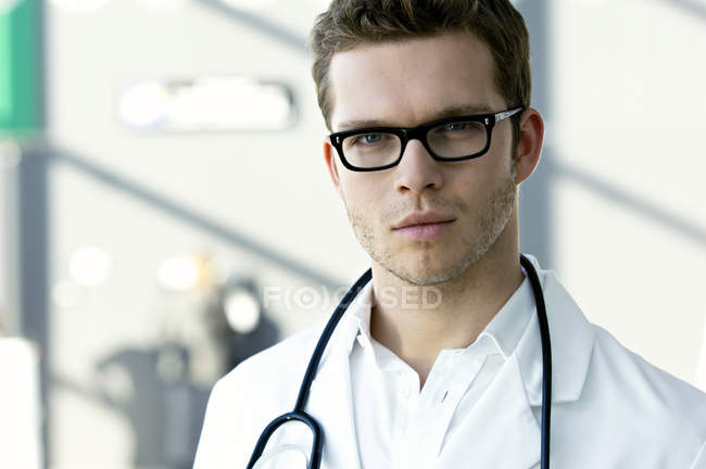 Portrait of male doctor with a stethoscope around neck — Stock Photo