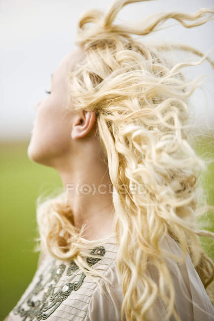Portrait of young blond woman outdoors — Stock Photo