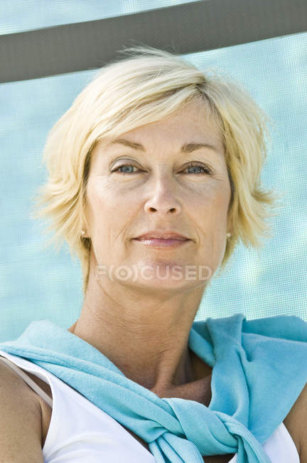 Portrait of mature blond confident woman with short hair — Stock Photo