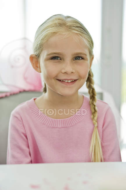 Portrait of smiling blonde girl with braids — Stock Photo