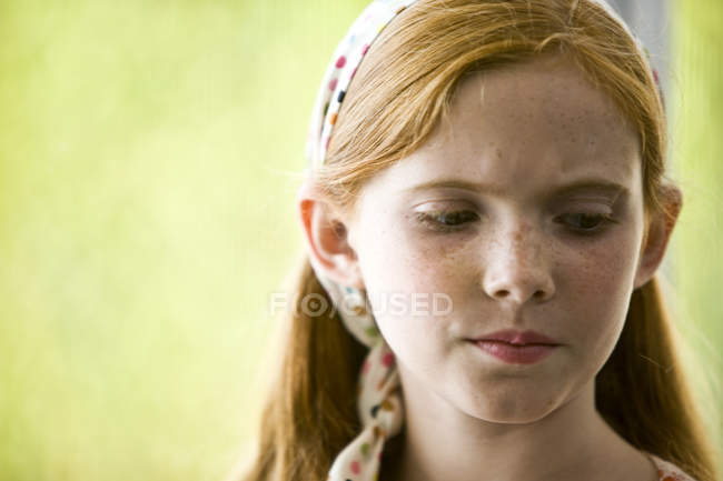Portrait of sad ginger girl with freckles looking away — Stock Photo