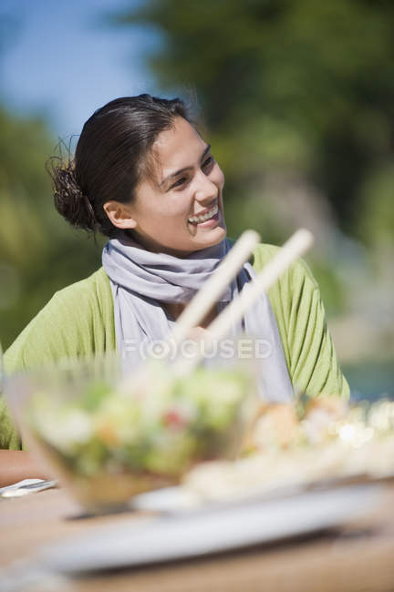 Smiling woman having lunch in outdoors — Stock Photo