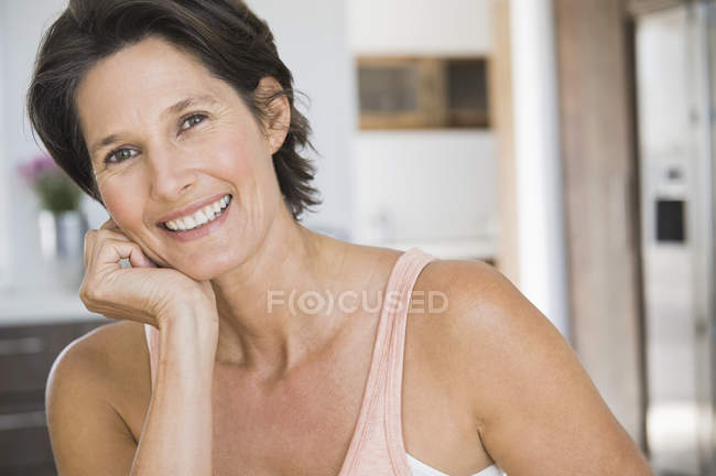 Portrait of smiling mature woman with short hair — Stock Photo
