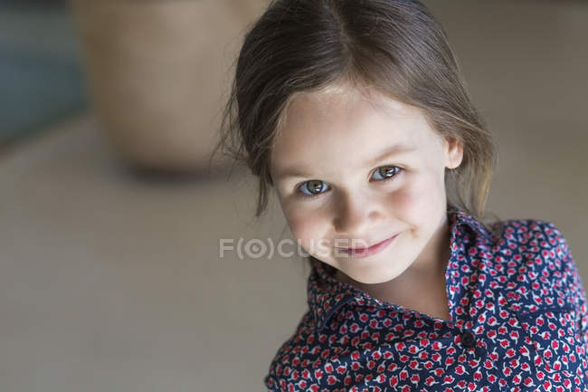 Portrait of cute little girl smiling indoors — Stock Photo