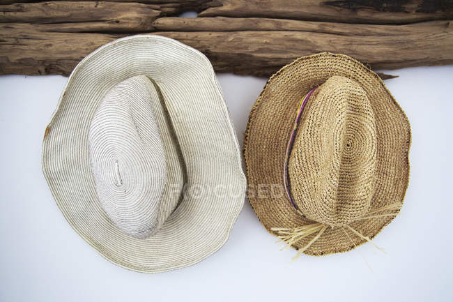 Close-up of two hats on white wall — Stock Photo