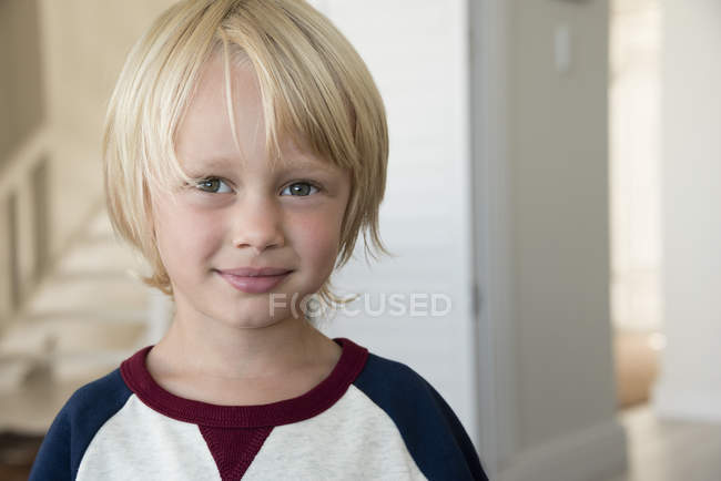 Portrait of happy little boy with blonde hair — Stock Photo