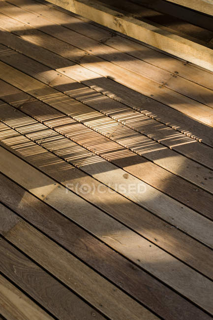 Shadow on wooden floor in daylight in house — Stock Photo