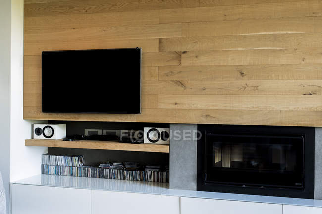 Television and shelves in modern living room — Stock Photo