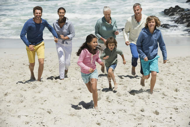 Happy family having fun on sandy beach — Stock Photo