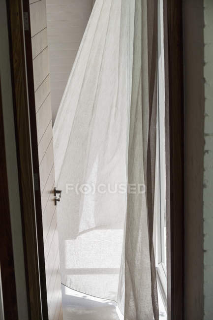 Close-up of open door and curtain in house — Stock Photo