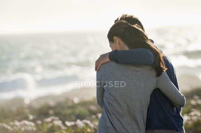 Close-up of romantic couple embracing on beach — Stock Photo