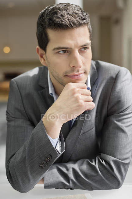 Close-up of confident businessman thinking in office — Stock Photo