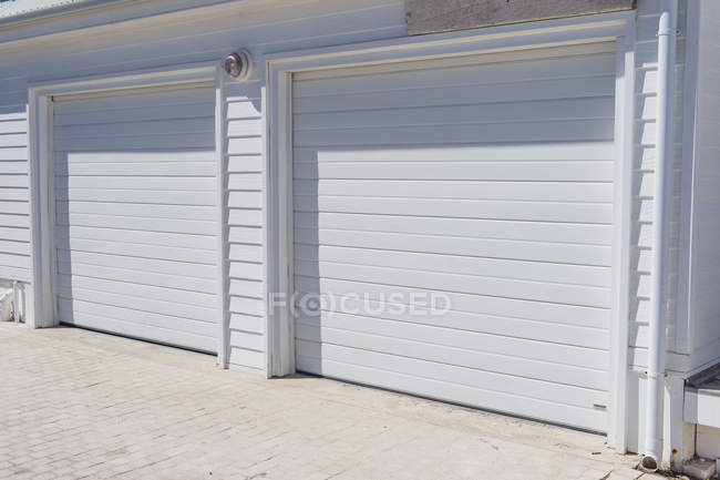 Closed white shutters of building — Stock Photo