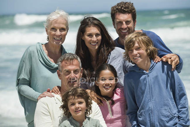 Portrait of happy multi-generation family on beach — Stock Photo