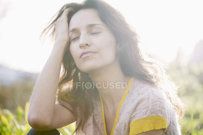 Relaxed woman with eyes closed dreaming outdoors — Stock Photo