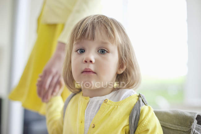 Portrait of cute little girl holding hand of parent — Stock Photo