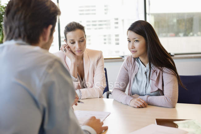 Business executive discussing with clients in office — Stock Photo