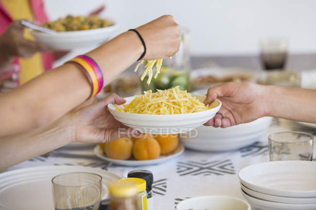 Friends having lunch at dining table — Stock Photo