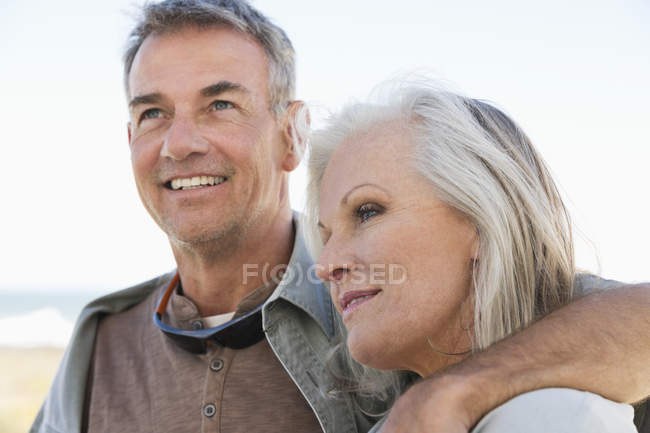 Close-up of romantic senior couple embracing outdoors — Stock Photo
