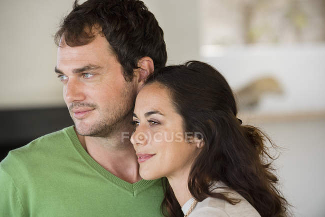 Close-up of dreamy couple smiling head to head — Stock Photo