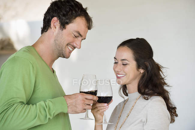 Couple toasting with wine glasses and smiling — Stock Photo