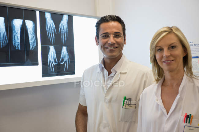 Portrait of doctors smiling with X-ray in hospital — Stock Photo