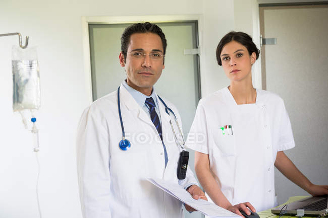 Portrait of doctor and nurse working in hospital — Stock Photo