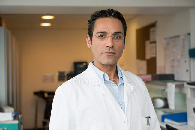 Portrait of male doctor standing in hospital — Stock Photo