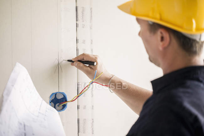 Close-up of male electrician working at site — Stock Photo