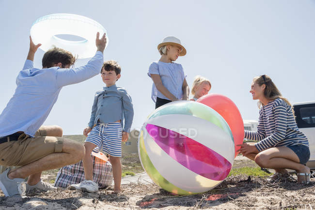 Family having fun on sunny summer beach together — Stock Photo