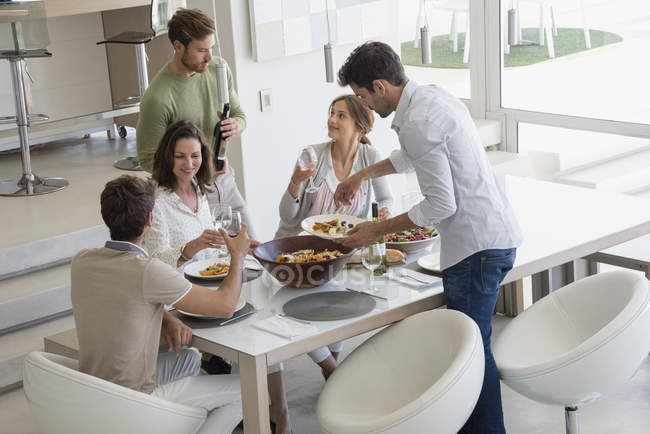 Group of friends enjoying party at home — Stock Photo