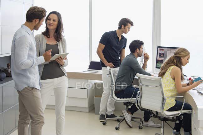 Business colleagues working in office together — Stock Photo