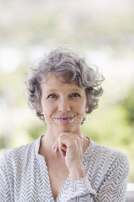 Portrait of smiling mature woman outdoors — Stock Photo