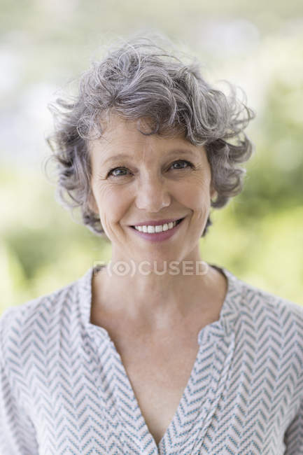 Portrait of happy mature woman outdoors — Stock Photo