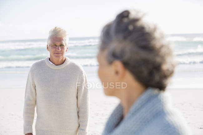Thoughtful senior man looking at wife on beach — Stock Photo