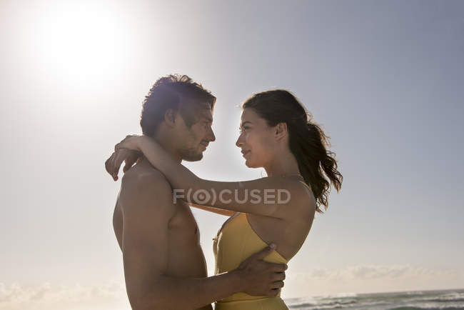 Happy young couple embracing against clear sky — Stock Photo
