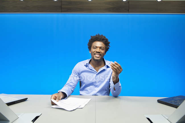 Businessman doing paperwork and smiling in conference room — Stock Photo
