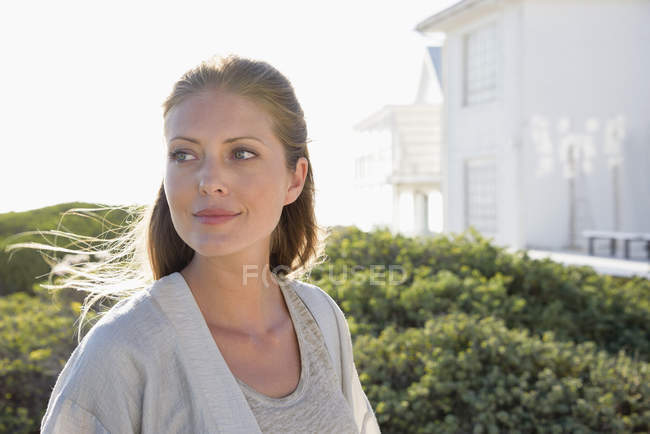 Close-up of smiling elegant woman standing outdoors — Stock Photo