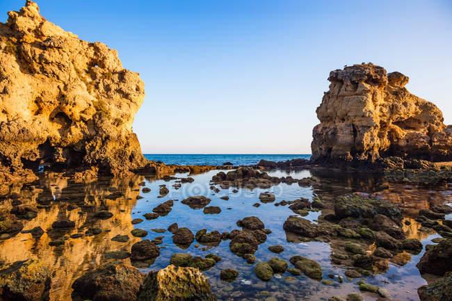 Rocks over sea water,