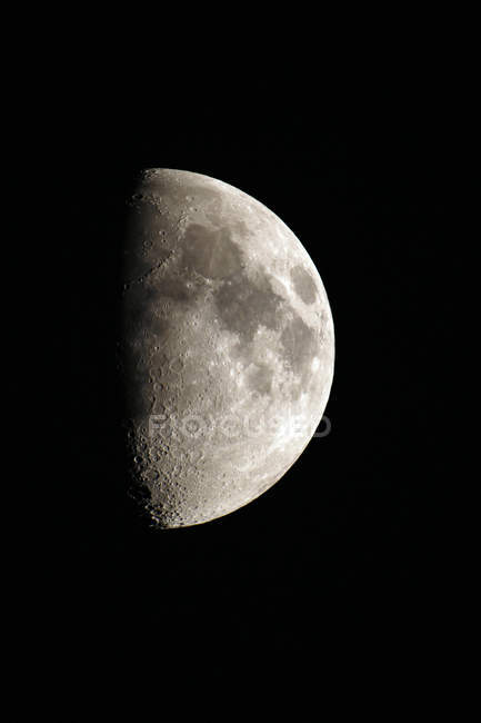 Close-up of crescent moon aged 8 days on black background — Stock Photo