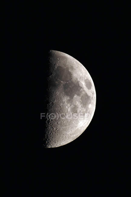 Close-up of first quarter moon on black background — Stock Photo