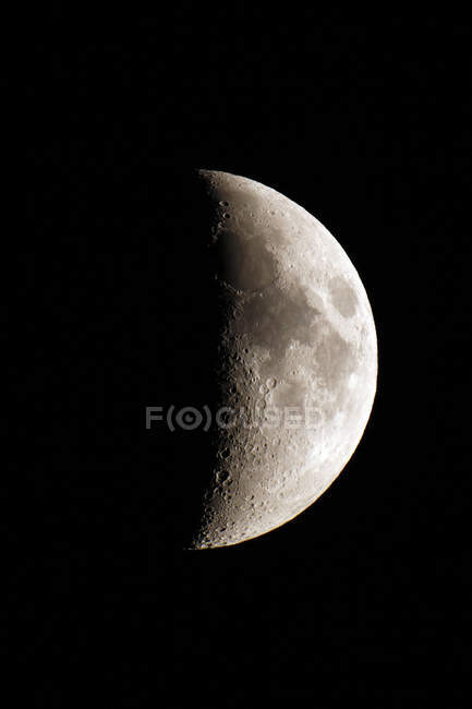 Close-up of crescent moon aged 7 days on black background — Stock Photo