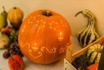 Autumnal carved pumpkin decoration with illumination. — Stock Photo
