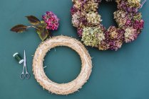 Still life of DIY autumnal wreath with hydrangea blossoms — Stock Photo