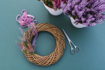 DIY autumnal willow wreath decoration with heather flowers — Stock Photo