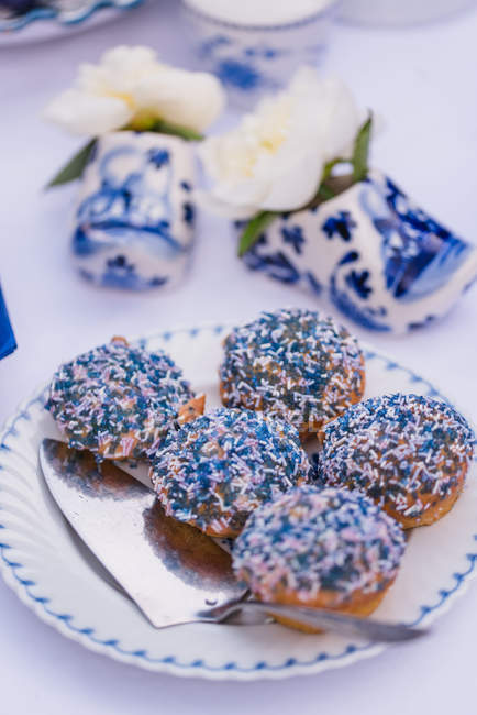 Easter table with decorated muffins in blue — Stock Photo